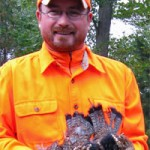Bob with his birds. (Photo: Pheasants Forever)